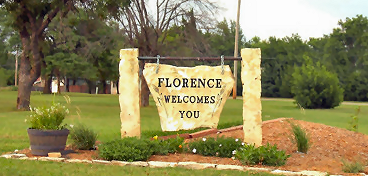 Stone Florence sign with plantings